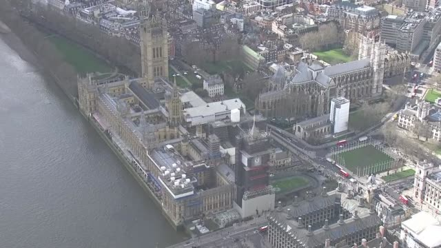 aerials of westminster and city / aerials elephant and castle incident england london westminster union jack on victoria tower / houses of parliament... - victoria tower stock-videos und b-roll-filmmaterial