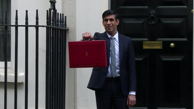 chancellor outlines spending plans in face of coronavirus threat; england: london: westminster: downing street: ext rishi sunak mp standing outside... - red stock videos & royalty-free footage