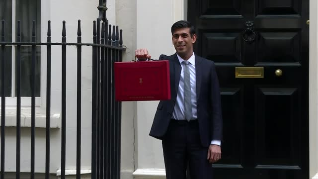 chancellor outlines spending plans in face of coronavirus threat; england: london: downing street: ext various shots of rishi sunak mp budget 2020... - red stock videos & royalty-free footage