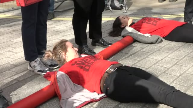 environmental protest at downing street gates england london westminster whitehall ext environmentalist protesters at downing street gates lying down... - environmentalist stock videos & royalty-free footage