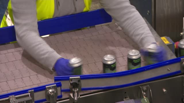 rishi sunak unveils covid recovery plan for uk economy; england: derbyshire: buxton: int various shots of workers working on production line in... - derbyshire stock-videos und b-roll-filmmaterial