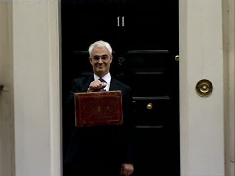 alistair darling leaving downing street england london downing street ext alistair darling mp with red budget box standing next to yvette cooper mp... - alistair darling stock videos & royalty-free footage