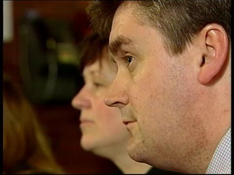 Brown increases spending ITN Kettering People sat in pub watching Gordon Brown's budget speech London CS Sign 'Whitehall' CS Feet of pinstripe...