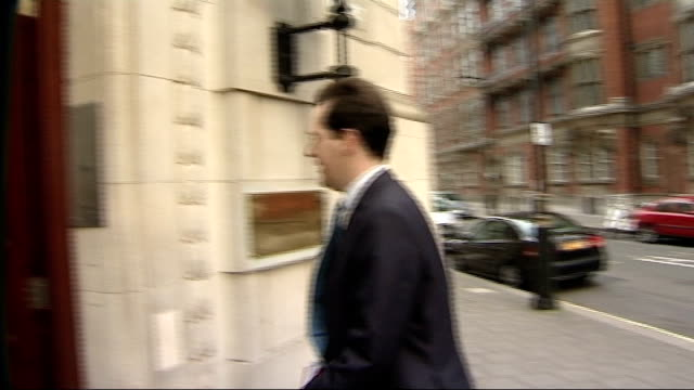 chancellor george osborne; england: london: millbank: ext * * some flash photography * * car arriving as george osborne mp out of car and into... - george osborne stock videos & royalty-free footage