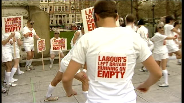 conservative supporters in alastair darling masks england london westminster ext conservative supporters dressed in white shorts and tshirts carrying... - running shorts stock videos & royalty-free footage