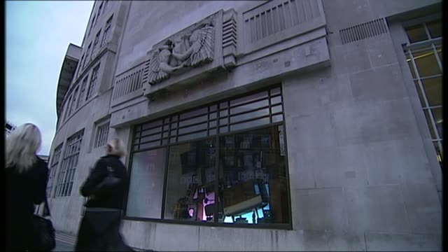 bbc 3 to go online date exterior of bbc broadcasting house sculpture on building bbc sign on window - キャシー・ニューマン点の映像素材/bロール