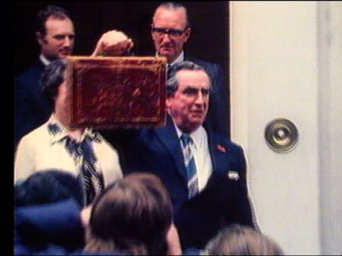 increased tax and health spending lib london downing street then chancellor of the exchequer denis healey mp holding up red brief case as posing for... - chancellor of the exchequer stock videos and b-roll footage