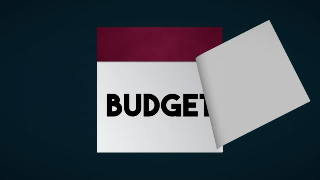 budget page on calendar 4k stock video - home finances stock videos & royalty-free footage