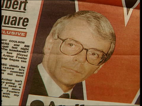 election prediction itn england london newspapers on stand with budget headlines 'everyone a winner' headline on daily express newspaper man standing... - john major stock-videos und b-roll-filmmaterial