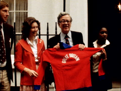 Sir Geoffrey Howe photocall ENGLAND London Downing Street EXT Sir Geoffrey Howe holding red 'Great Britain' sweater Howe and others outside Number 11...