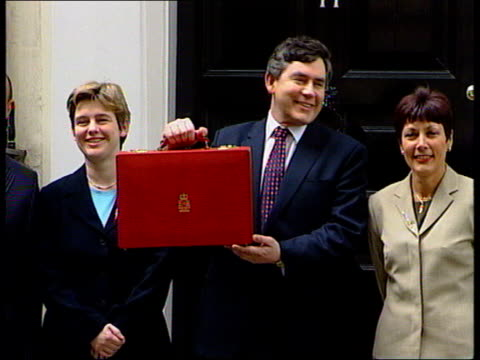 Speech ITN ENGLAND London Downing Street EXT Chancellor Gordon Brown MP holding budget box posing for photocall with Treasury Ministers Paul Boateng...