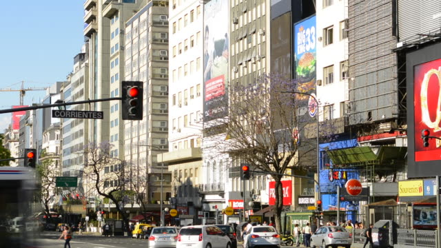 buenos aires argentina 9 de julio avenue the widest street in the world with traffic at corrientes street and billboards - avenida 9 de julio video stock e b–roll