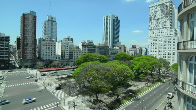 buenos aires argentina 9 de julio avenue the widest street in the world with traffic next to lima avenue eva peron mural in skyscraper windows - avenida 9 de julio stock videos & royalty-free footage