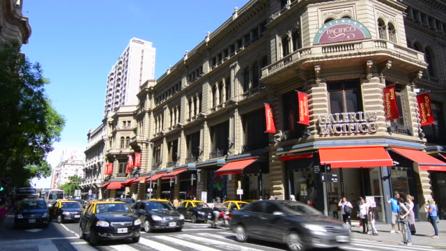 buenos aires argentina galerias pacifico famous mall for shopping and dining in city center entrance and traffic outside - argentina stock videos and b-roll footage