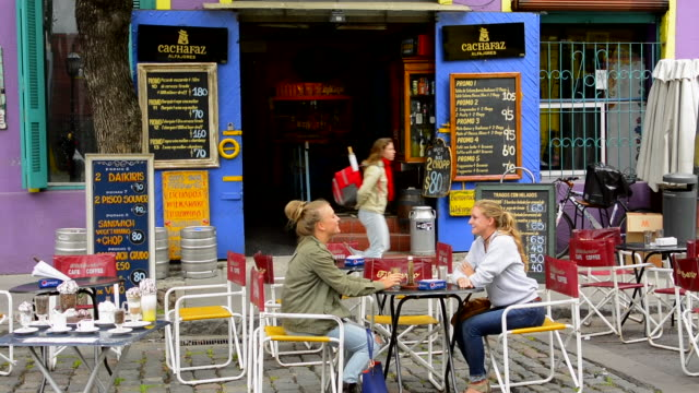 Buenos Aires Argentina La Boca colorful restaurant with young women having drink at the cafe