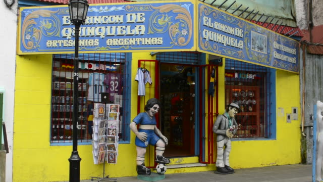 Buenos Aires Argentina La Boca colorful shops with statues and souvenirs to sell