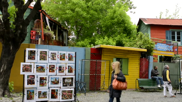 Buenos Aires Argentina La Boca colorful street selling paintings and drawings for tourists with bright primary colors
