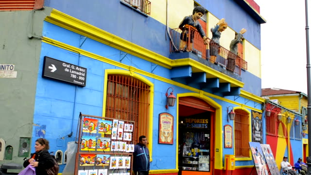 buenos aires argentina la boca colorful street with murals on roof of building - buenos aires stock videos & royalty-free footage