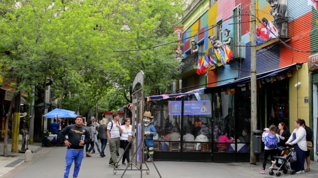 Buenos Aires Argentina La Boca colorful street with shops with people walking