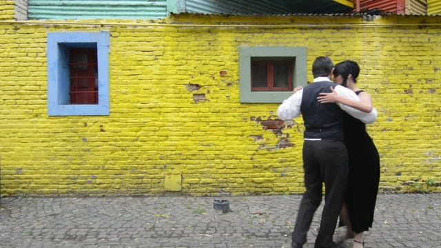 buenos aires argentina la boca tango dance with couple on street with colors worn walls with passion model released mr mr-1 man  and mr-2 woman - tango dance stock videos & royalty-free footage