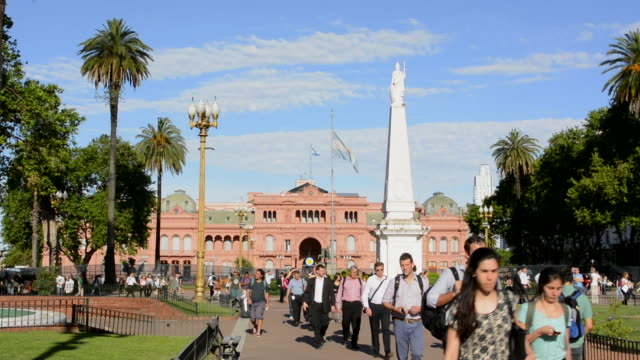 Buenos Aires Argentina Plaza de Mayo with Pink House Casa Rosada in square in city center with Argentine flag  and people walking