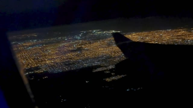 buenos aires at night from the airplane with the wing silohuette