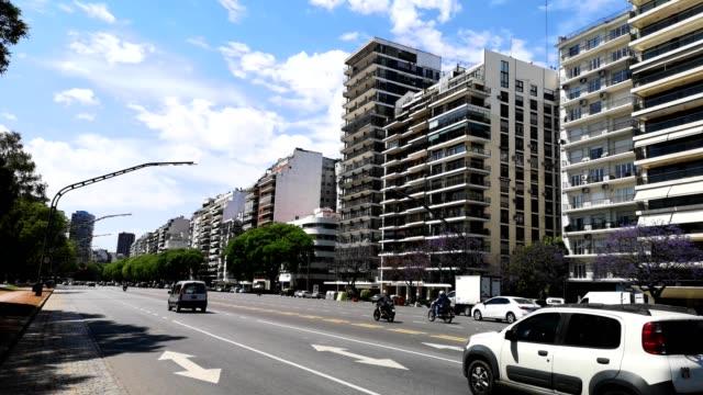 buenos aires avenida del libertador daytime city scene 4k video - cultura argentina video stock e b–roll