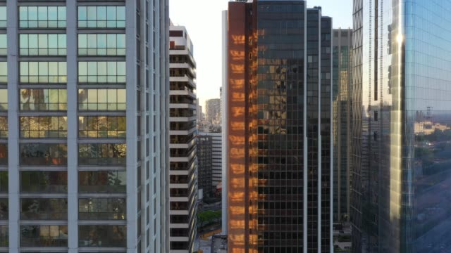 buenos aires building facades with sunset reflections - facciata video stock e b–roll