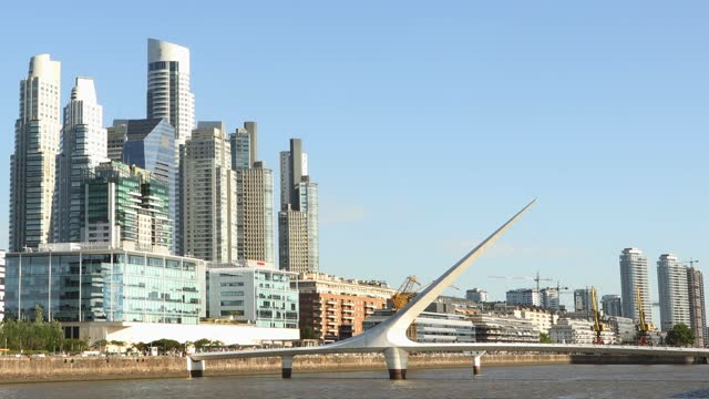 buenos aires puerto madero wide view canal with skyscrapers and the puente de la mujer bridge - puerto madero stock videos & royalty-free footage