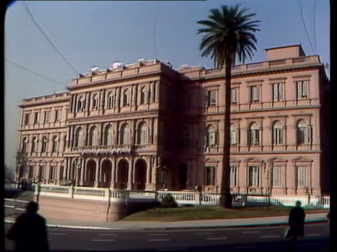 buenos aires vid itn via sat gv exterior of government house side two soldiers in tin hats naval officers as greeted by others - buenos aires province stock videos & royalty-free footage