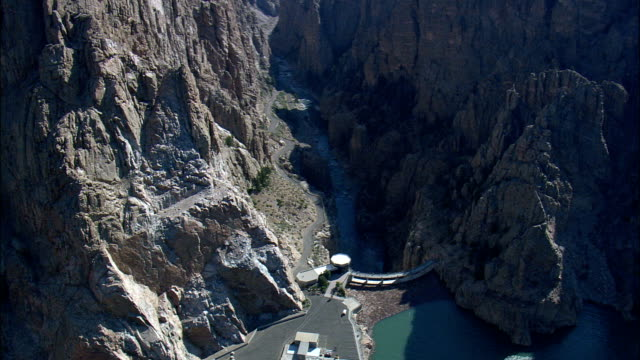 buffalo bill dam  - aerial view - wyoming,  park county,  helicopter filming,  aerial video,  cineflex,  establishing shot,  united states - dam stock videos and b-roll footage