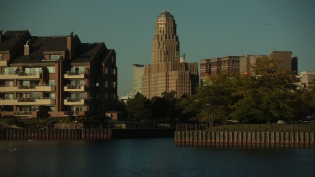 buffalo city hall stands past the erie basin in buffalo, new york, us, wide shots of buffalo city hall from a marina on lake erie - buffalo new york state stock videos & royalty-free footage