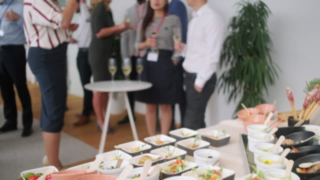 buffet of small dishes and colleagues enjoying office party - large group of people stock videos & royalty-free footage