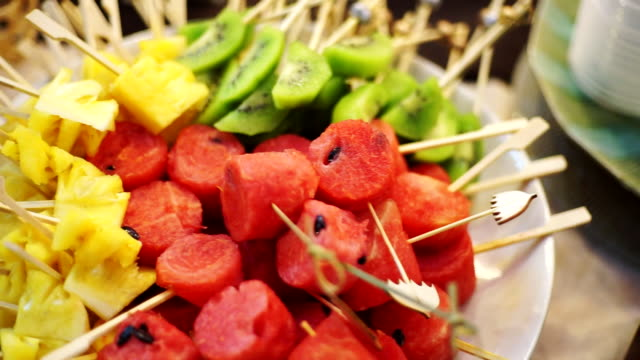 buffet served by various fruit canape on skewers for a self service buffet table. - skewer stock videos & royalty-free footage
