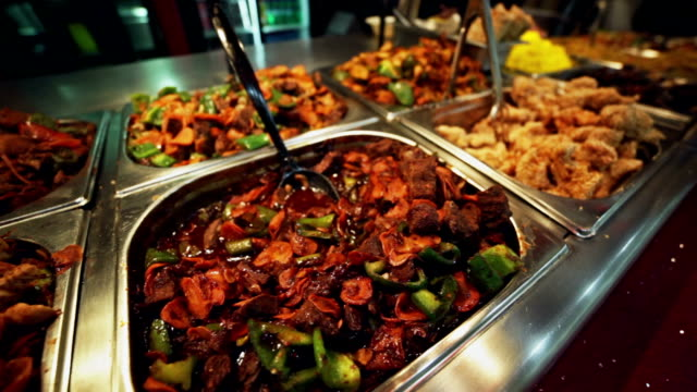 buffet - variety of  meat dish. food background - buffet stock videos & royalty-free footage
