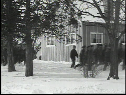 bugler blowing taps outside barracks / men walking through snow / men standing at attention / ccc troops holding flag, in formation - 1934 stock videos & royalty-free footage