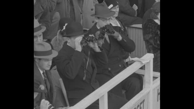 stockvideo's en b-roll-footage met cu bugler sounds call at horse race / crowds at the pimlico futurity race at pimlico race course in baltimore md / horses parade to post / men in box... - maryland staat