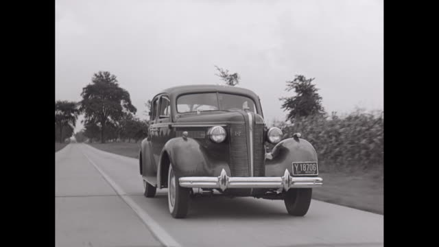 vídeos de stock e filmes b-roll de ws pov 1938 buick car driving on country road / united states - 1930