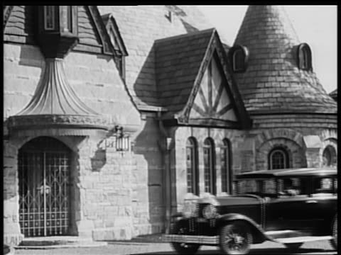 b/w 1928 buick pulling up to fancy house / industrial - 1928 stock videos & royalty-free footage