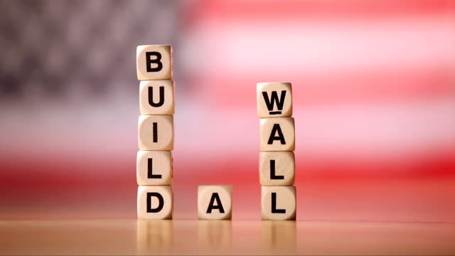 build a wall spelled in letter cubes - toy block stock videos and b-roll footage