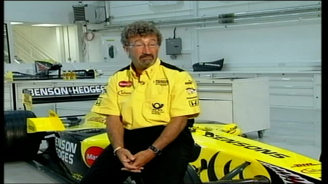 eddie jordan interview itn england northamptonshire silverstone eddie jordan seated on jordan formula one racing car as interviewed sot / gvs female... - personal land vehicle stock videos & royalty-free footage