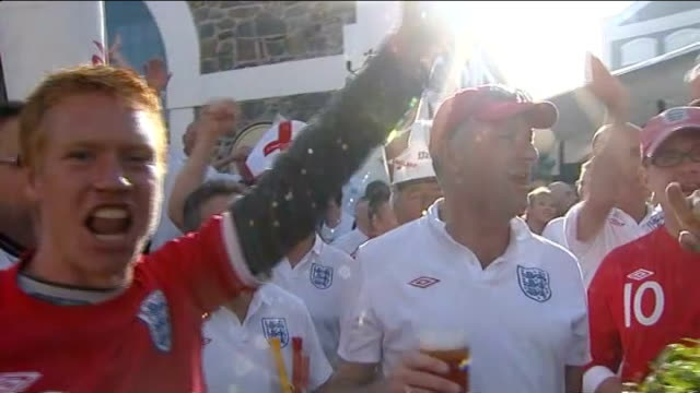 build up to england v algeria england fans holding up pints of lager singing 'england' sot - lager stock videos & royalty-free footage