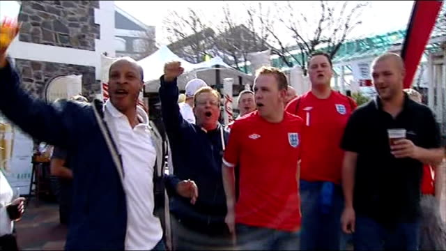 build up to england v algeria south africa cape town ext england fans some holding pints of lager singing 'we love you england' sot giant st georges... - lager stock videos & royalty-free footage