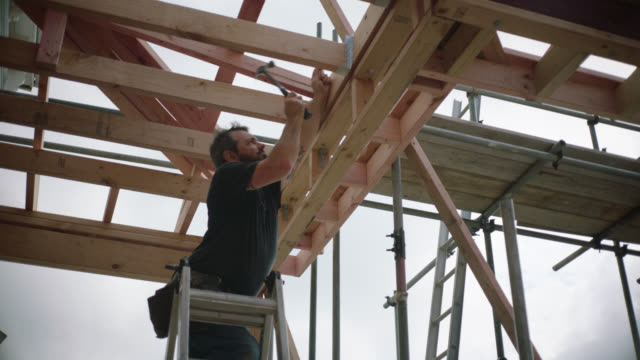 builder hammering in a nail - scaffolding stock videos & royalty-free footage