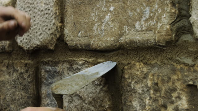 builder pointing wall - stone material stock videos and b-roll footage