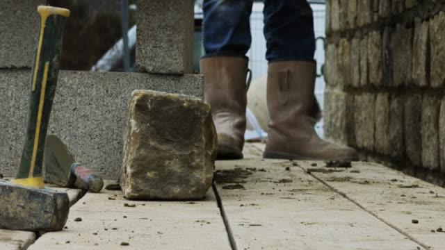 Builder Walking Along Construction Platform