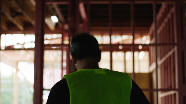 Builder walks through construction site