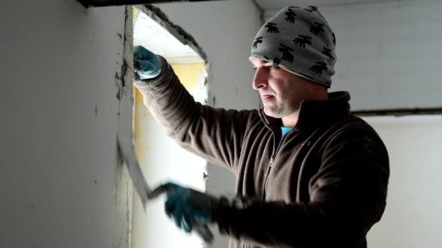builder works inside a house. - ukrainian ethnicity stock videos and b-roll footage