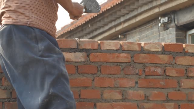 builders build walls with red bricks - brick wall stock videos & royalty-free footage