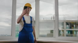Builders making a selfie with his phone Construction site
